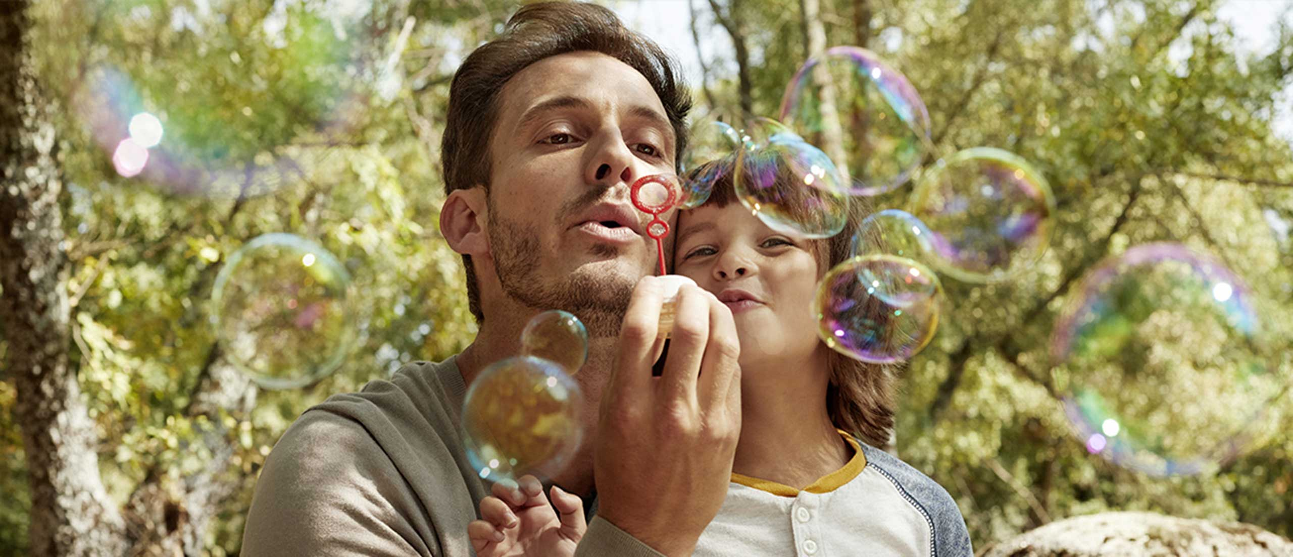 Father and Son blow bubbles together
